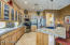 Granite, glass fronted cabinets, LG stainless appliances, pendant lighting over island