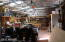 Interior of metal building, set up as woodshop. Has power to it