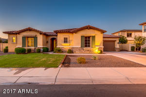 Front view of this beautiful home, 3 car garage, north/south exposure, RV gate, corner lot.