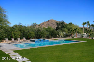 Over 1.2 Acre Lot is lushly landscaped
