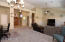 Open Living Room & Dining Area, looking toward entryway. Formal Dining Room currently used as office.