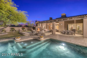 Another view of this low maintenance backyard with pool surrounded by travertine pavers!