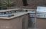 Outdoor kitchen with high end Lynx barbeque appliances