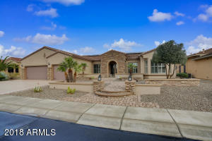 Extraordinary curb, elevated lot, paver walkway, gated courtyard with travertine floor, coated driveway, lighting