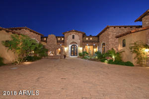 The double iron doors, huge motor court, front patios and lush landscaping welcome you into the spectacular estate!