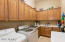 Spacious laundry room with lots of cabinets!