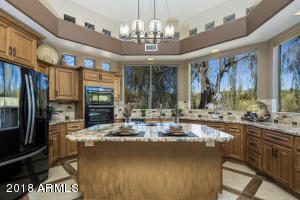 Enjoy absolute serenity in this gourmet kitchen with mountain views!
