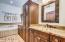 CUSTOM BATH WITH NEW CABINETS, WALK IN CLOSET, GRANITE AND ARTISTIC SINKS!