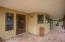 FABULOUS PATIO! THIS IS TILED AND RUNS THE ENTIRE LENGTH OF THE HOME TO MASTER BEDROOM!