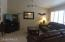 Great family room- with vaulted ceiling, fan and plantation shutters