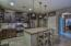 Stainless steel appliances as well as a stylish custom subway tile backsplash!