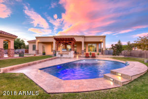 Decked out backyard is complete with oversized patio, ramada, built in BBQ and sparkling pool!