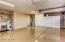 3 car garage with epoxy floors, built-in cabinets & utility sink