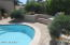 Pool with sitting area and paver patio