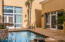 #2 courtyard pool is a perfect sanctuary to read a book next to the cascading water feature