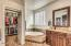 Large master bath with soaking tub, linen closet and large walk-in closet.