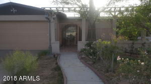 Front walkway is inviting and has a hidden oasis in the front yard! Please come and see it?