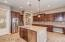 Generous cabinets and lighting n this spacious kitchen