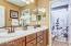 Dual raised vanities, new quartz counters, sinks, and oil rubbed bronze fixtures