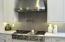 6 burners, pot filler, griddle cook plate, led lights, red warming lights, fan. All set for a chef!