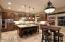 GOURMET CENTER ISLAND KITCHEN OPENS TO THE FAMILY ROOM