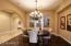 POLISHED WOOD FLOORING AND CUSTOM CHANDLIER....GRACIOUS DINING