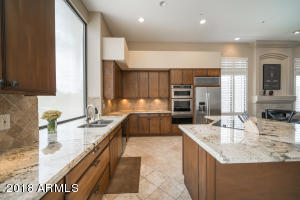Ample space for cooking and hosting guests in this gorgeous kitchen.