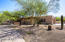 Set back from the street with a paved circular parking and side entry garage with extended pad