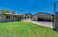 Covered Patio, grassy yard, view with garage door opened.