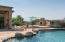 Pool View to Pool's Gas Fireplace Raised Seating Area and Gas Grill Island