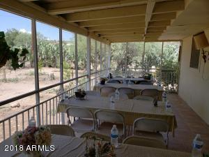 West facing covered patio of main house