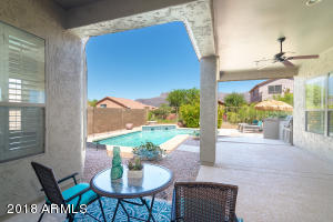 Covered rear patio has views of the Superstition Mountains, pool and is shaded to avoid the hot sun.