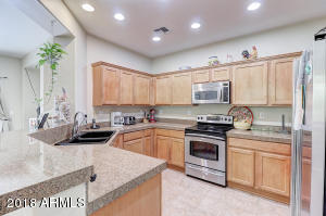 kitchen marble counter top with stainless steel appliances
