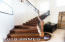 Gorgeous wood stairs with wrought iron detail railing