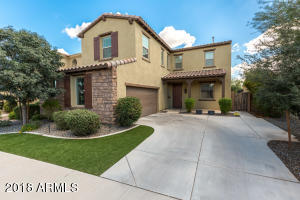 Curb appeal galore with artificial grass and mature landscaping. Stone and stucco front. Side entry garage. North/South exposure.