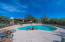 Expansive cool deck to place lounge chairs or table and chairs for poolside dining.