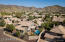 The home is set on a corner lot, for extra privacy and around the corner from miles of hiking trails in South Mountain Park.