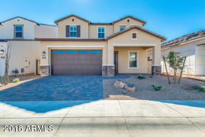 Beautiful North facing home! Features an inviting front porch and upgraded iron front door!
