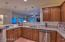 Kitchen with granite tile counters and newer appliances