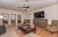 Charming family room off kitchen has a private balcony