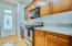 Amazing galley style kitchen with stainless steel appliances, granite counters and recessed lighting!
