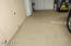 GARAGE FLOOR HAS EPOXY FINISH FOR EASY CLEANING.