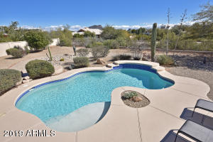 Enjoy this incredibly spacious backyard with Mountain Views and a wash with walking trails behind.