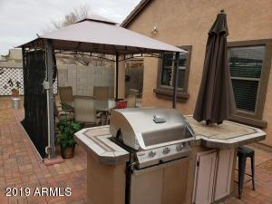 Gazebo, grill and the table and chairs for 2 convey with the home