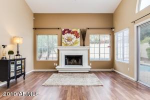Family room with fireplace and sliding doors to backyard