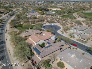 Overview of home showing solar, two homes away from cul-d-sac and within walking distance to community center, pool, spa, tennis