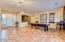 Soaring ceilings, French double doors to your exquisite backyard, Plantation Shutters at front door entry, Model Home drapery, surround sound speakers, built in cabinets and shelving, two tone paint, tile flooring