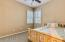 Soaring ceiling, Plantation Shutters, ceiling fan, carpet, mirrored closet doors, two tone paint