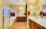 Soaring ceiling, separate Master Bathroom vanities, inviting garden tub, stand up shower, acrylic glass block window, upgraded light fixtures, two tone paint