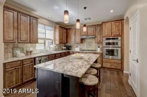 Timeless cabinets and granite. Wall oven with microwave on top. Large pantry.